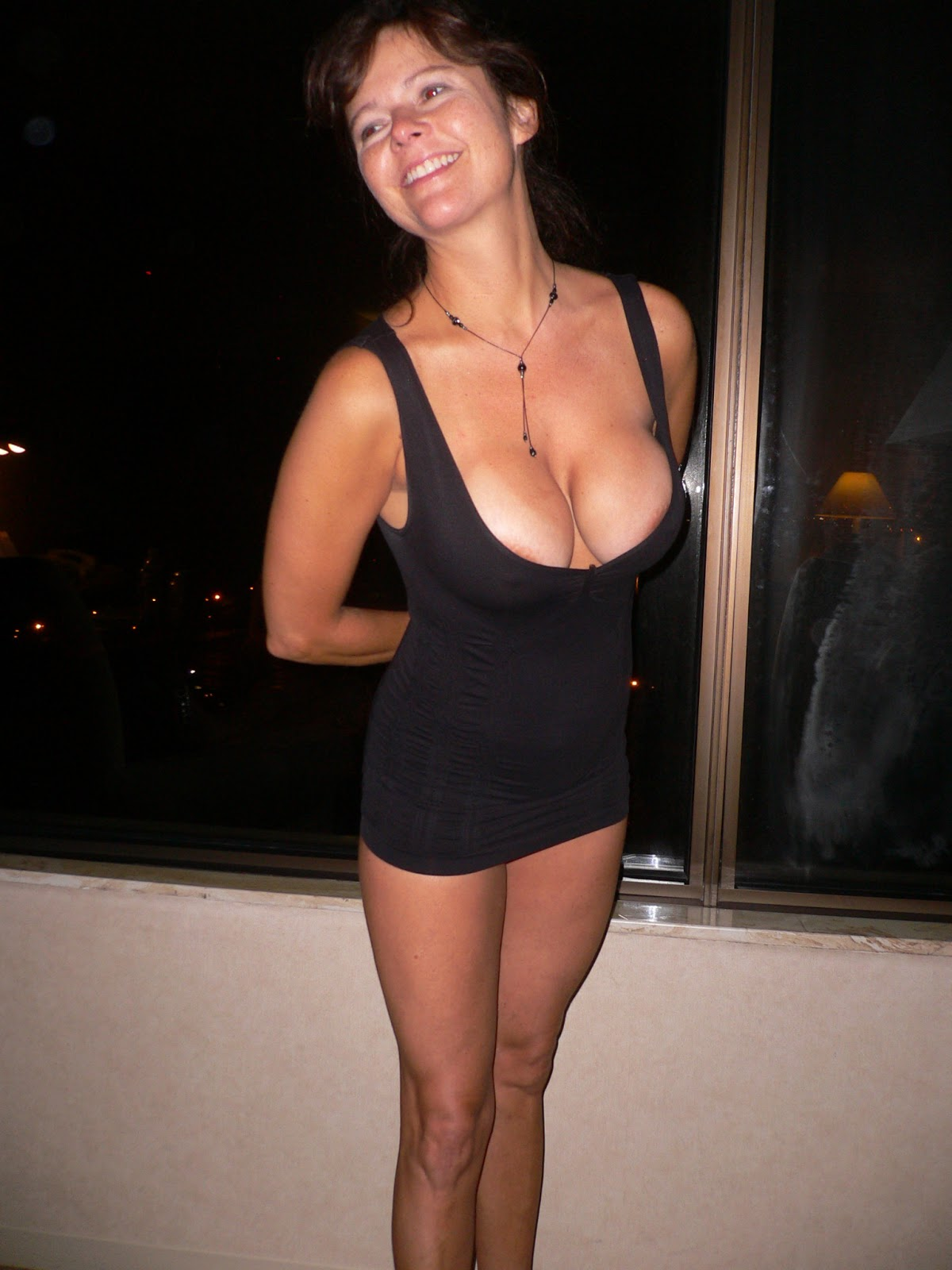 stacked-milf-in-a-tight-little-black-mini-dress
